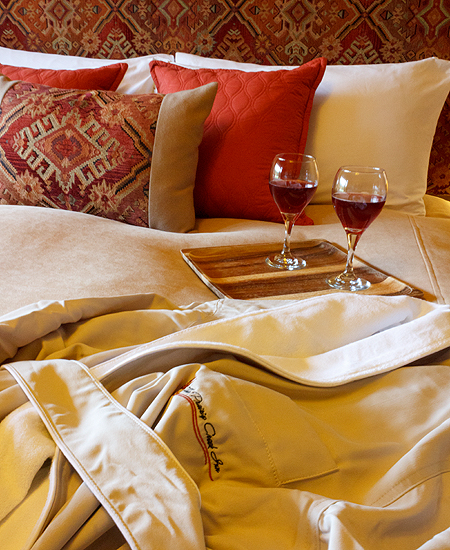 Wine and Robe on Bed ~ The Prairie Creek Inn