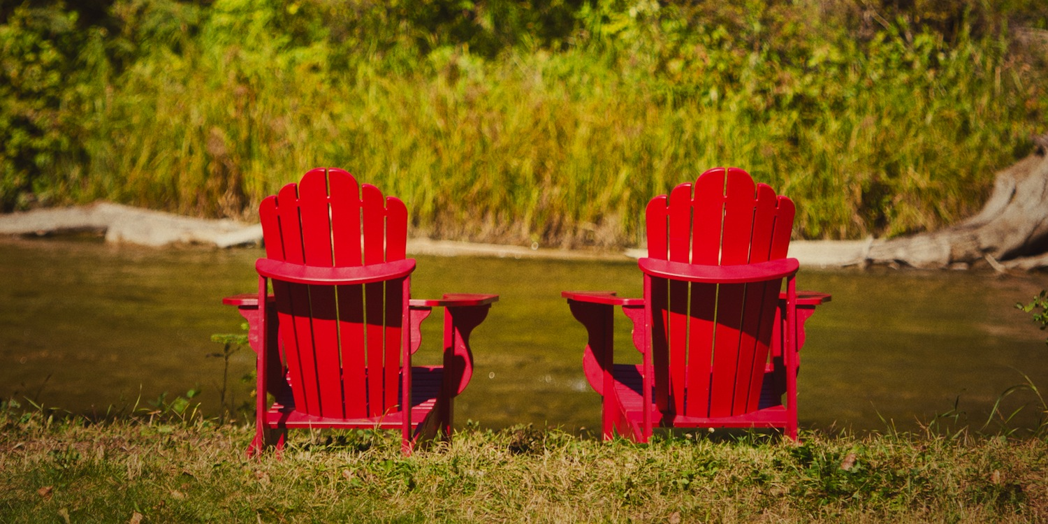 Red Adarondak Chairs ~ The Prairie Creek Inn