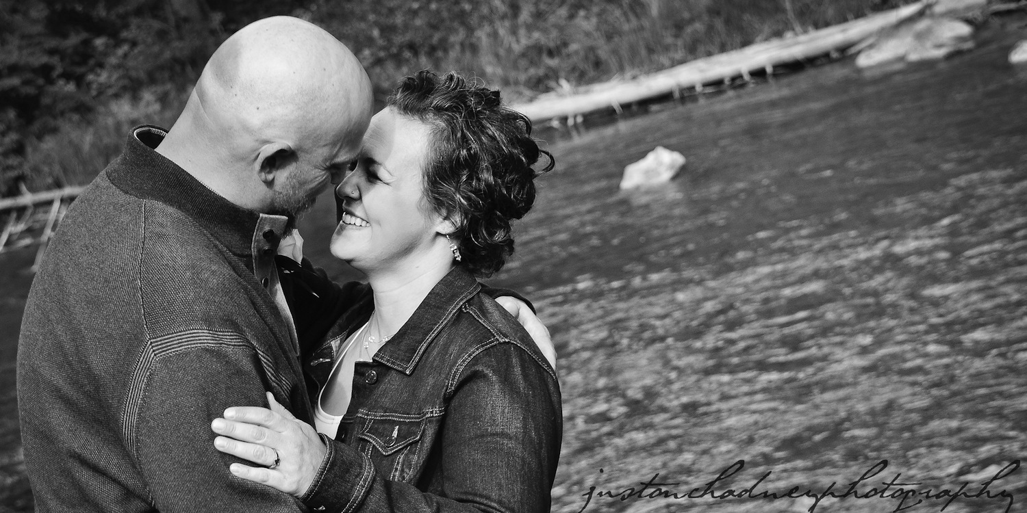 Laughing Couple by Creek ~ Justin Chadney Photography ~ The Priaire Creek Inn
